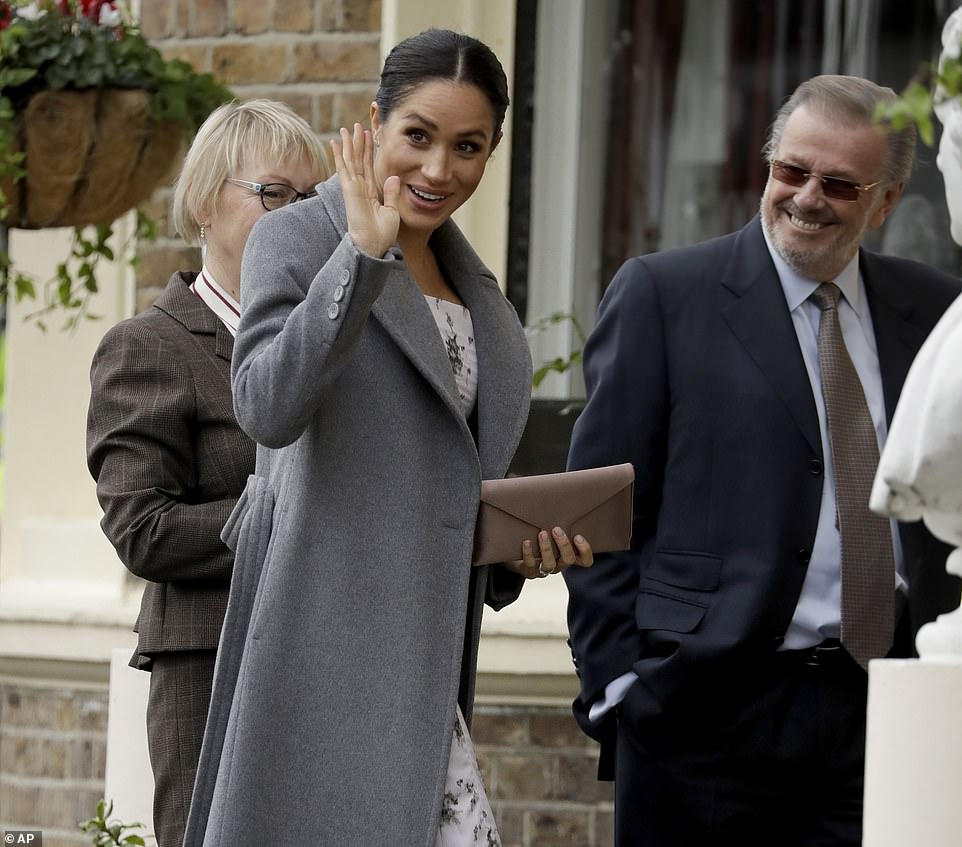 Pregnant Meghan Markle Shows Burgeoning Baby Bump In